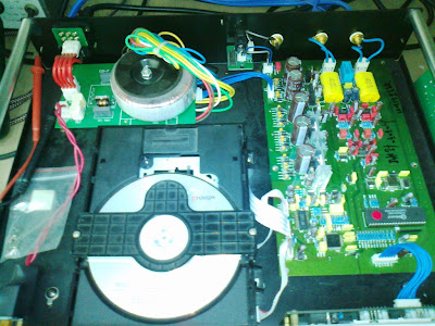 A further look of the near complete CD player, with toroidal power supply transformer on the back of the CD transport and the DAC and output PCB board, as seen above, occupying the left side of the chassis.