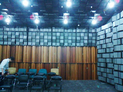The larger auditorium has wooden diffusers built in to the rear wall.